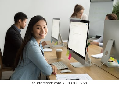 Smiling asian office employee looking 260nw 1032685258