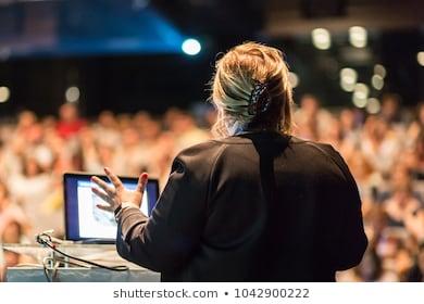 Female speaker giving talk on 260nw 1042900222